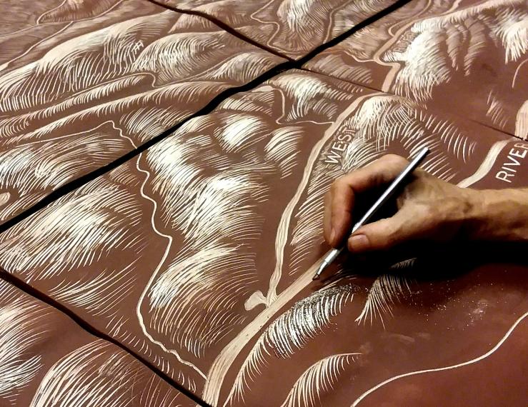 Hand carving a landscape.