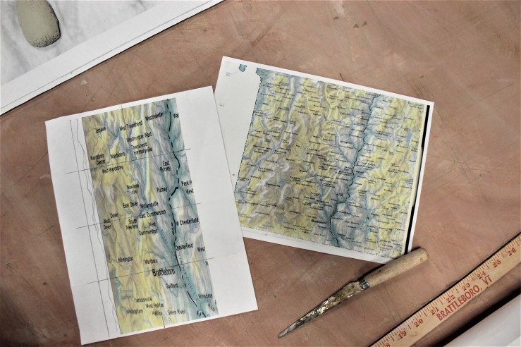 Maps of Brattleboro area on drafting board.