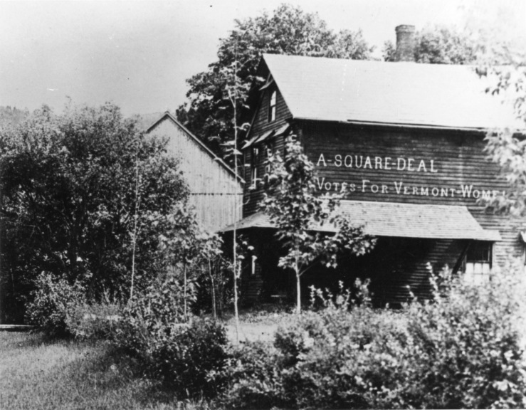"A painted sign on side of barn reads ""A Square Deal - Votes For Vermont Women"""